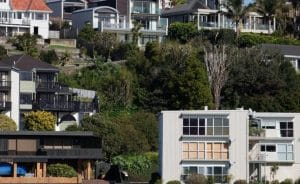 New Zealand slaps taxes on investors to cool housing market